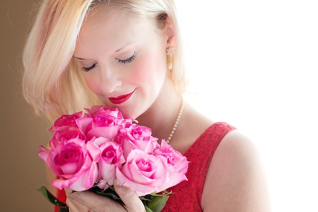 Happy woman with a romantic flowers
